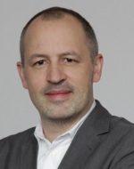 Dr. Henning Becker